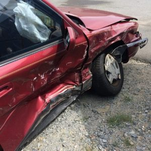 car accident personal injury lawyer red car with one side badly damaged